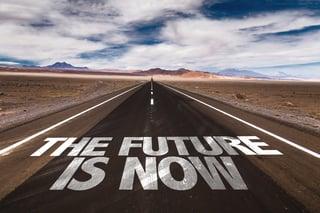The Future is Now written on desert road.jpeg